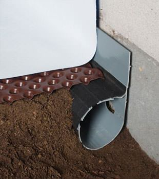 Closeup of a crawl space drainage system installed in Johnstown