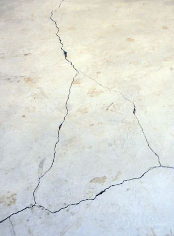 severely cracked, heaving slab floors in a home in Fort Edward