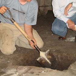 Digging a hole for the engineered fill used in a crawl space support system installation in Ballston Spa