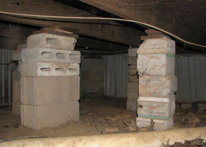 crawl space repairs done with concrete cinder blocks and wood shims in a Gansevoort home
