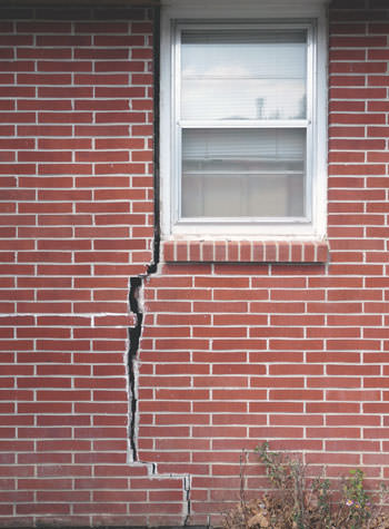 severe foundation wall cracks along a window in Waterford