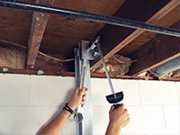 Straightening a foundation wall with the PowerBrace™ i-beam system in a Latham home.