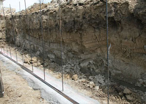Soil layers exposed while excavating to construct a new foundation in Hudson