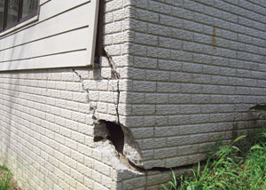 A severely damaged foundation wall in Gloversville