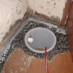 Installing a sump in a sump pump liner in a Troy home