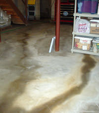 Flooding entering a basement through a floor crack in Johnstown
