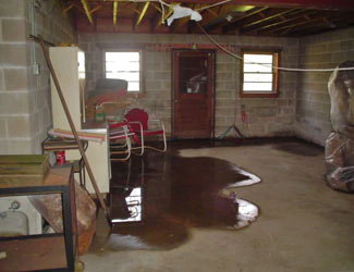 a flooded basement floor in a Castleton On Hudson home