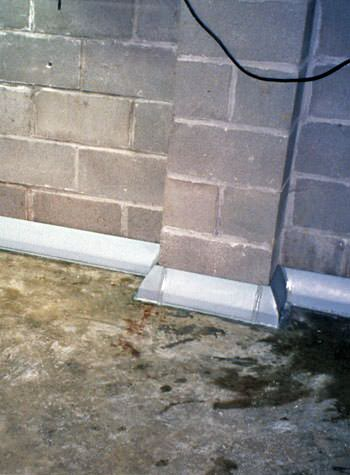 Baseboard weeping tile system for homes with monolithic foundations and thick floors