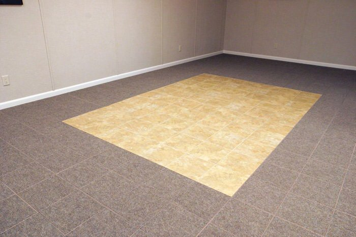 tiled and carpeted basement flooring installed in a Clifton Park home