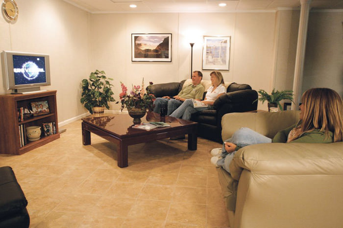 A basement finished into a comfortable family room. ... & Basement Floor Tiles | Schenectady Troy Albany